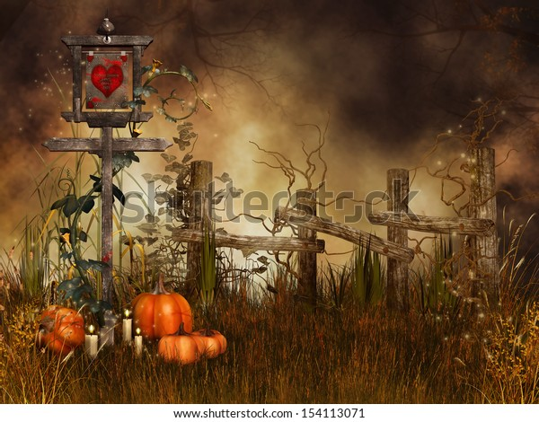 Halloween pumpkins on a meadow by a wooden fence