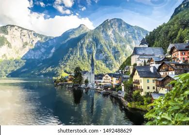Hallstatt, Austria. Mountain village in the Austrian Alps - Watercolor style.