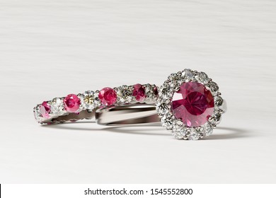 Halo set ruby and diamond engagement ring, eternity ring on white background. 3D illustration