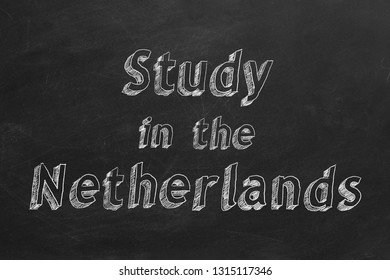 "Hand drawing ""Study in the Netherlands"" on black chalkboard. 2D illustration."
