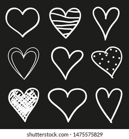 Hand drawn abstract hearts on black background. Sketchy elements for design. Black and white illustration