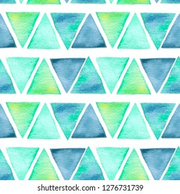Hand drawn watercolor pattern with green and indigo triangles