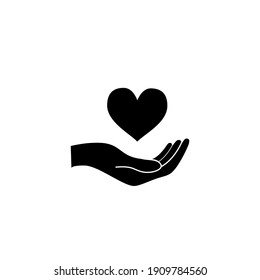 Hand hold a heart, healthcare concept black icon isolated on white