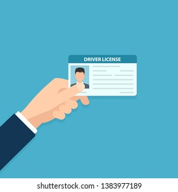Hand holding car driver license. Clipart image