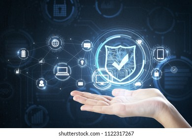 Hand holding creative digital shield on blurry background. Internet safety concept. 3D Rendering