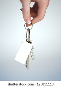 Hand holding keys with key chain having room for text ,graphic or copy space. Vehicle ownership , insurance,service ect. Gradient background