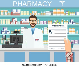 hand holding a prescription rx form. Interior pharmacy or drugstore with male pharmacist at the counter. Medicine pills capsules bottles vitamins and tablets.
