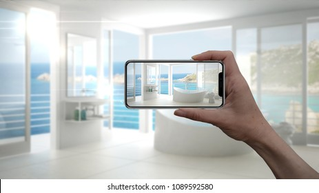Hand holding smart phone, AR application, simulate furniture and interior design products in real home, architect designer concept, blur background, modern bathroom, 3d illustration