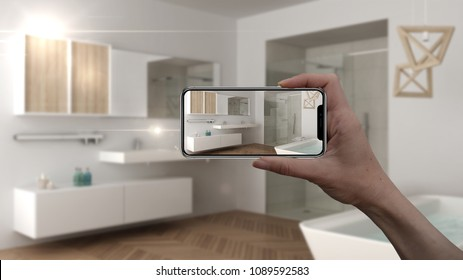 Hand holding smart phone, AR application, simulate furniture and interior design products in real home, architect designer concept, blur background, scandinavian bathroom, 3d illustration
