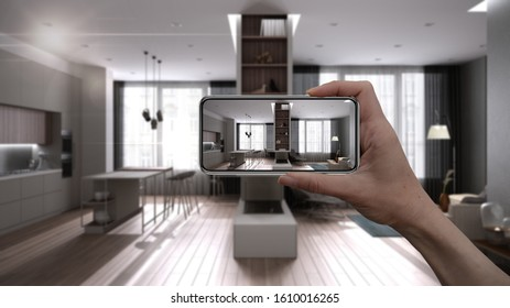 Hand holding smart phone, AR application, simulate furniture and interior design products in real home, architect designer concept, blur background, modern kitchen and living room, 3d illustration