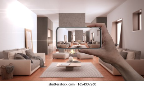 Hand holding smart phone, AR application, simulate furniture and interior design products in real home, architect designer concept, blur background, cosy living room with sofa, 3d illustration