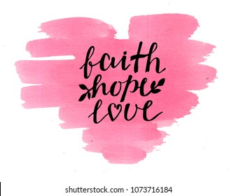 Hand lettering Faith, hope and love on watercolor heart. Bible verse. Christian poster. New Testament. Modern calligraphy. Scripture prints. Card. Greeting. Quote