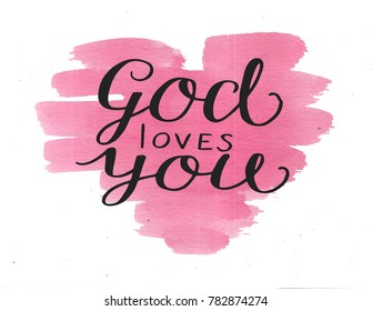 Hand lettering God loves you on watercolor background . Biblical background. Christian poster. Card. Modern calligraphy