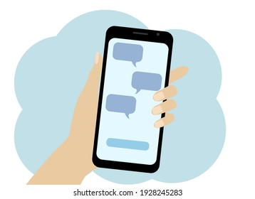 Hand with a mobile phone. Online correspondence on the phone