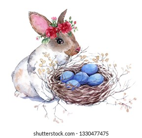 Hand painted isolated on white background watercolor Easter bunny in a floral wreath with  a bird's nest and blue eggs. Spring holiday design.