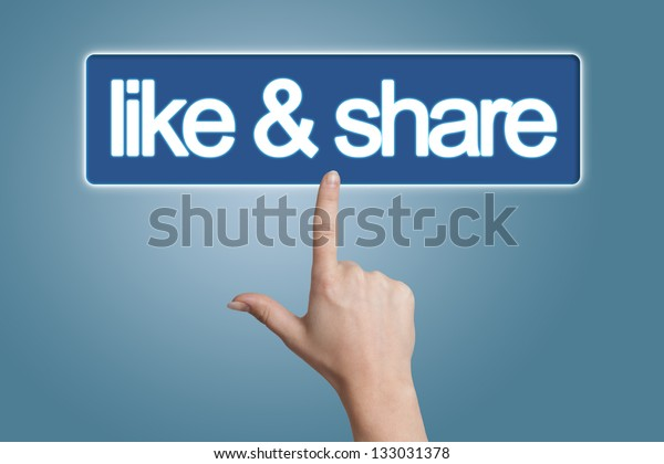 Hand pressing like & share button isolated on blue background