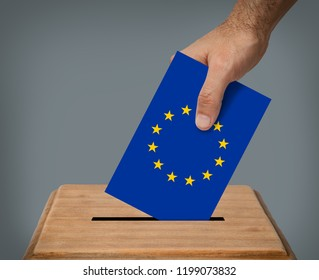 Hand putting a blank voting ballot with the EU flag into the box .