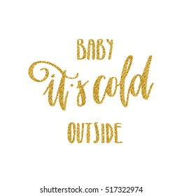 Hand written winter phrase - Baby it's cold outside. Golden glitter calligraphy isolated on white background. Great element for your Christmas design