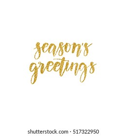 Hand written winter phrase - Season's greetings. Golden glitter calligraphy isolated on white background. Great element for your Christmas design