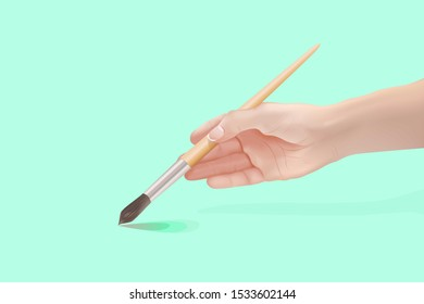 Hand of young girl holding paintbrush Design