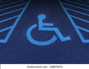 Handicapped and disabled symbol as a parking space with a wheelchair painted on asphalt as a health care and medical icon of reserved space for accessibility of the physically challenged.