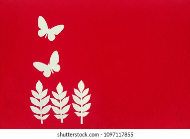 Handmade papercut work with butterfly and tree on the red artboard with text spcace or copy space
