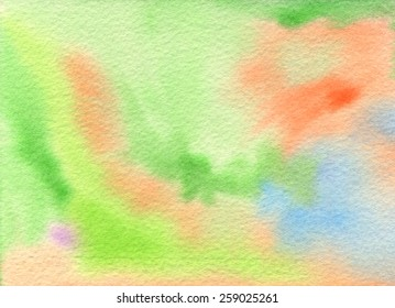 Hand-painted background in light tones of green, orange, blue and just a touch of purple. Abstract watercolor painting on rough watercolor paper. Hand drawn using transparent watercolor paint.