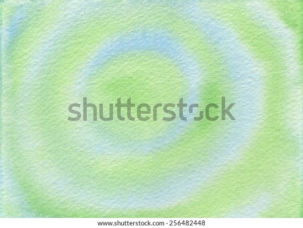 Hand-painted circles in alternating green and blue, shaped like tree rings or bulls eye.