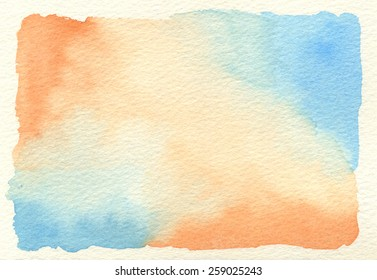Hand-painted watercolor background in orange and blue gradations, on rough, cream-colored watercolor paper. Hand drawn using transparent watercolor paint on paper.