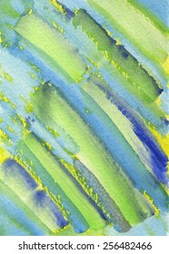 Hand-painted watercolor background texture in tones of green, blue and yellow. It is an abstract painting depicting bamboo.