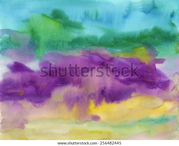 Hand-painted watercolor background texture in tones of purple, green, turquoise and yellow. It is an abstract painting depicting a field of irises in Summer.