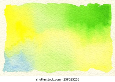 Hand-painted watercolor background in yellow, green and blue gradations, on rough, cream-colored watercolor paper. Hand drawn using transparent watercolor paint on paper.