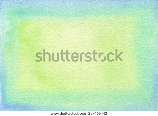 Hand-painted watercolor frame with light blue, green and yellow green tones, on rough-textured watercolor paper.
