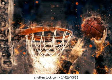 The hands of the basketball player throws the ball in the basket. Effect of fire