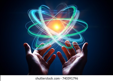 Hands holding abstract digital atom on blue background. Future concept. 3D Rendering