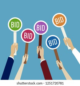 Hands holding auction paddle with bid