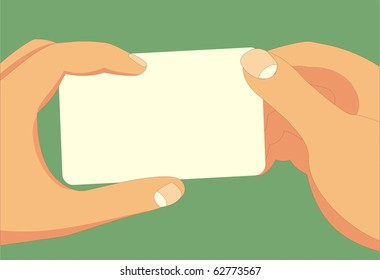 Hands holding a card