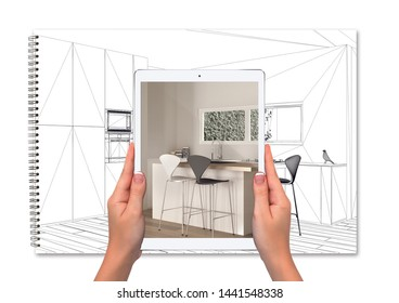 Hands holding tablet showing kitchen, notebook with blueprint sketch in the background, augmented reality concept, application to simulate furniture and interior design products, 3d illustration