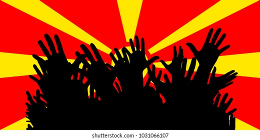 Hands up silhouettes on a Macedonia flag. Crowd of fans, cheerful people at a party