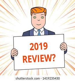 Handwriting text 2019 Review Question. Concept meaning remembering past year events main actions or good shows Smiling Man Holding Formal Suit Big Blank Poster Board in Front of Himself.