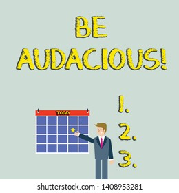 Handwriting text Be Audacious. Concept meaning Takes risks in order to achieve something Unconventional Daring Businessman Smiling and Pointing to Colorful Calendar with Star Hang on Wall.