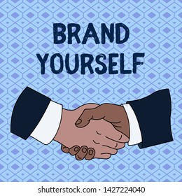 Handwriting text Brand Yourself. Concept meaning Develop a unique professional identity Personal product Hand Shake Multiracial Male Business Partners Colleagues Formal Shirt Suit.