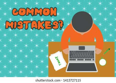 Handwriting text Common Mistakes question. Concept meaning repeat act or judgement misguided or wrong Upper view young man sitting working table laptop documents coffee cup pen.