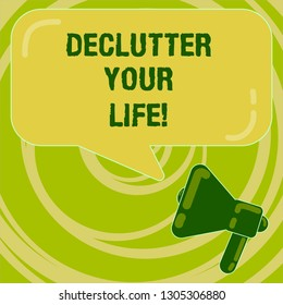 Handwriting text Declutter Your Life. Concept meaning remove unnecessary items from untidy overcrowded place Megaphone photo and Blank Rectangular Color Speech Bubble with Reflection.