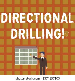 Handwriting text Directional Drilling. Concept meaning drilling for oil which the well not drilled vertically Businessman Smiling and Pointing to Colorful Calendar with Star Hang on Wall.