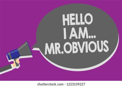 Handwriting text Hello I Am.. Mr.Obvious. Concept meaning introducing yourself as pouplar or famous person Man holding megaphone loudspeaker speech bubble message speaking loud.