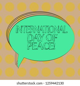 Handwriting text International Day Of Peace. Concept meaning Worldwide peaceful celebration Hope freedom Blank Oval Outlined Solid Color Speech Bubble Empty Text Balloon photo.