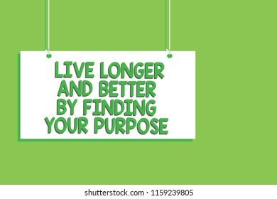 Handwriting text Live Longer And Better By Finding Your Purpose. Concept meaning Look for a goal set mission Hanging board message communication open close sign green background.