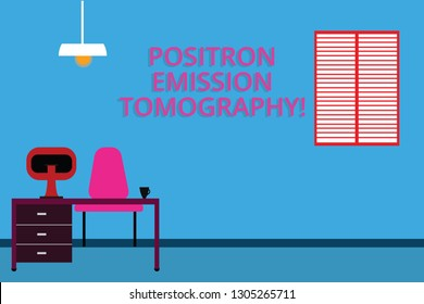 Handwriting text Positron Emission Tomography. Concept meaning Nuclear medicine functional imaging technique Work Space Minimalist Interior Computer and Study Area Inside a Room photo.