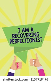 Handwriting text I Am A Recovering Perfectionist. Concept meaning Obsessive compulsive disorder recovery Man woman hands thumbs up approval speech bubble origami rays background.